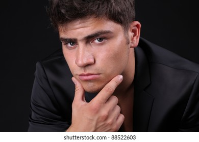 Close up of man with a serious look over black background