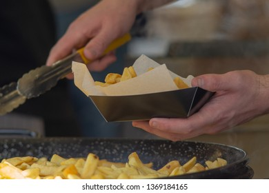 close up of man serving chips into a wrapping