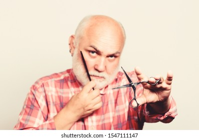 Close up of man shaving. shaving scissors tool kit. cut and brush hair. mature bearded man isolated on white. barbershop concept. shaving accessories. unshaven old man has moustache and beard.