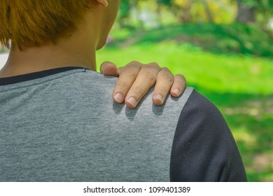 Close up of Man with shoulder pain or neck pain ,Health concept