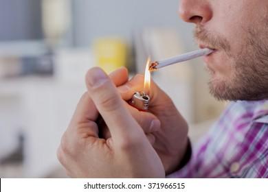 Close up of Man smoking cigarette. Man lighting the cigarette.