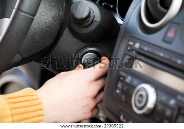 close up of man turning on his car.