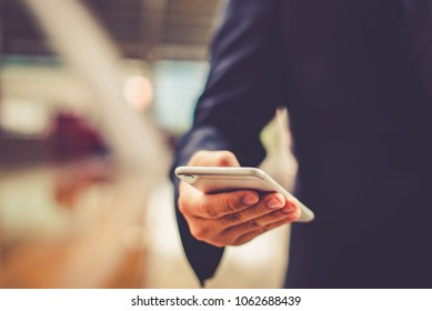 Close up of a man using mobile smart phone,copy space.