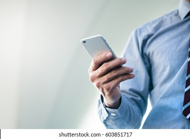 Close up of a man using mobile smart phone at outdoor