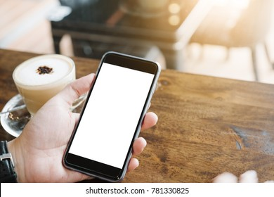 Close up of man using mobile smart phone,sending massages on the garden.having sunbath.Phone with black screen,texting,video calls,