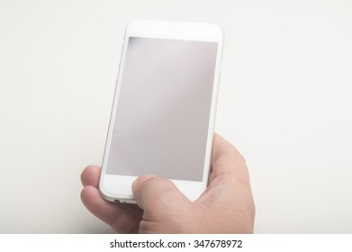Close up of a man using a smart phone
