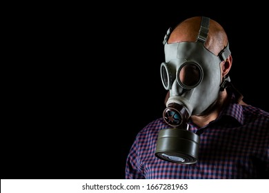 Close up of man wearing gas mask against coronavirus, covid 2019 on a black background, healthcare concept