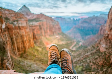 Close up of man wearing mountain boots and landscape of mountain