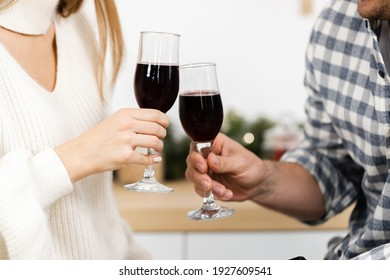 Close up of man and woman drinking red wine