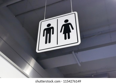 Close up of man and woman washroom logo on roof
