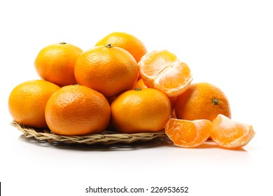 Close up of a mandarin orange isolated over white background.
