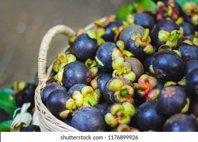 close up Mangosteen in fruit basket - Shutterstock ID 1176899926