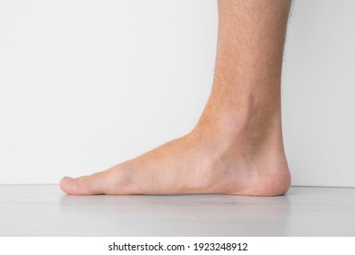 Close up of mans bare foot with strong flat feet also called pes planus or fallen arches. - Shutterstock ID 1923248912