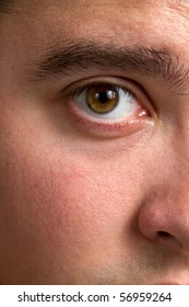 Close up of man's bloodshot eye.