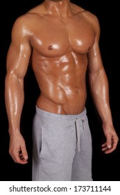 a close up of a man's body sweating after a workout.