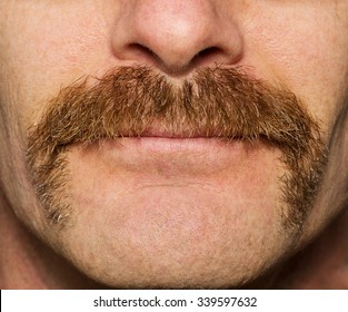 close up of mans face with one month old mustache