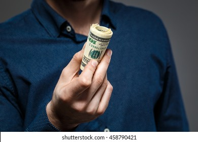 Close up of man's hands holding money.