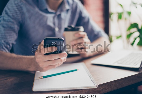 Close up of man's hands texting and receiving messages on  telephone
