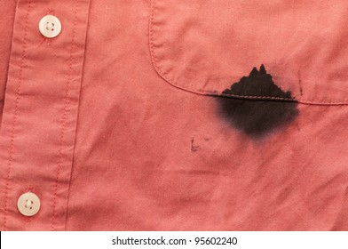 Close up of a Man's Red Shirt Stained by a Leaky Ink Pen
