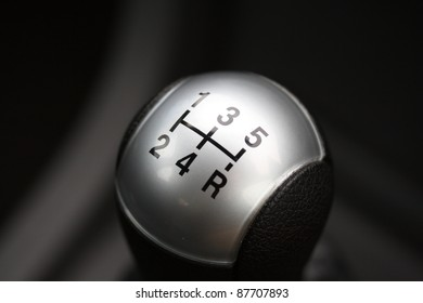Close up of a manual transmission gear lever knob