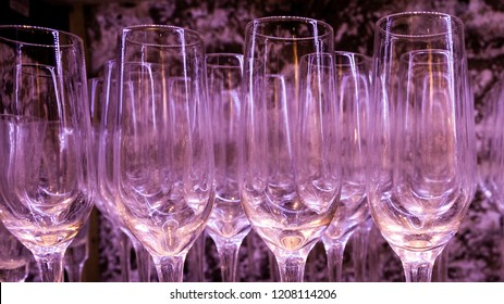 close up of many different wine glasses and stemware