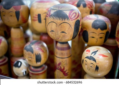 Close up of Many old Kokeshi Dolls