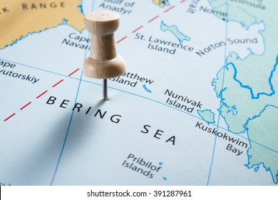 close up of  map with the words Bering Sea in focus with a push pin marking the spot
