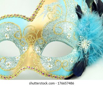 Close up of a Mardi Gras mask with jewels isolated on white background.