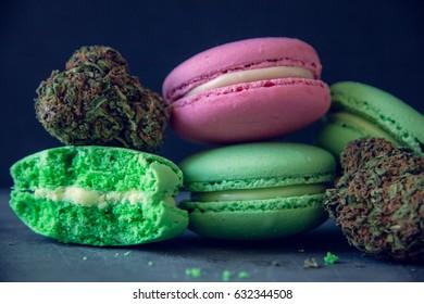 Close Up Marijuana Edibles With Cannabis Nugs On Dark Slate Background. Selective Focus.