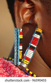 A close up of a Masai Mara ear decoration