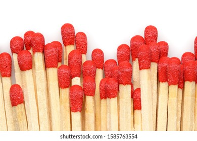 close up of matches with red head on white