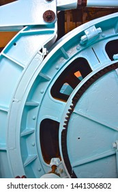 Close up of mechanic, blue wheel used in tin mining process