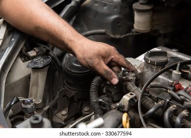 Close up of mechanic hand fix the engine