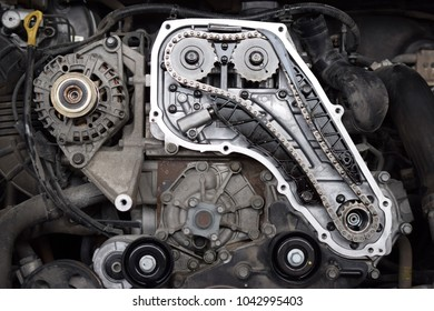 Close up of the mechanics of a car engine. front view