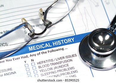 Close up of a Medical History form and a doctor's Stethoscope