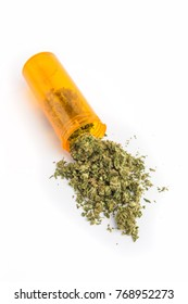 Close up of medical marijuana in yellow pill bottle on white background