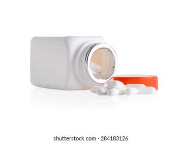 Close up Medicine pills and bottle on white background