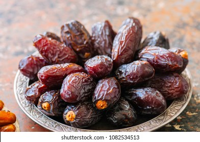 Close up of medjoul - dried dates or kurma in a vintage plate.
