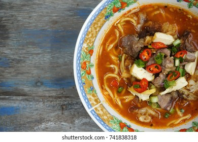 Close up of Mee Kuah, a famous Asian noodle served with meet vegetables. Selective focus