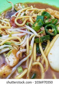 Close up of Mee Rebus. One of the local dish in Malaysia. Consists of yellow mee, boiler egg, beansprout, green chilies and meat.