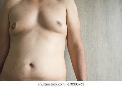 close up men boob with belly fat on fat man