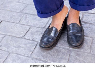 Close up of men food wearing vintage genuine leather shoes with Loafer style or vintage leather loafer shoe on the brick road