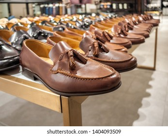 Close up of Men's leather shoes loafers displayed in shopping mall.