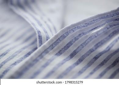 Close up of mens striped shirt.