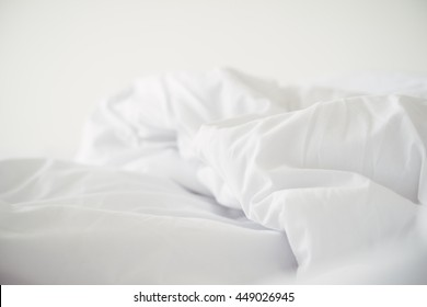 Close up of a messy bedding sheet after night sleep.Selective focus.Still life.