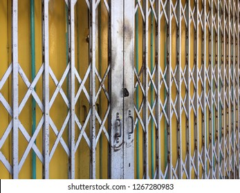 Close up of a metal collapsible sliding grille door normally use at shop houses in Asia