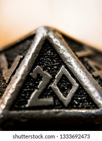 Close up Metal D20 On a Wood Table