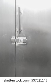 Close up metal door lock in public toilet