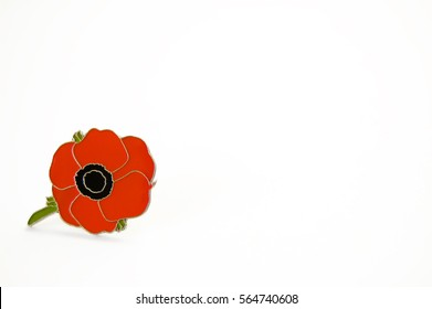 Poppy badge images stock photos vectors shutterstock close up of metal enamel red poppy flower pin with green leaves on white background mightylinksfo