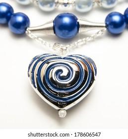 Close up of metal heart pendant
